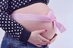 Pregnant woman from ribbon. Pregnant woman from pink ribbon stock image