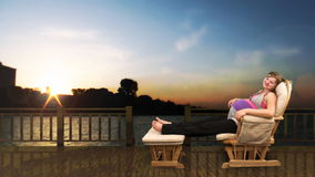 Pregnant woman on rocking chair city skyline at sunset, stock footage stock video