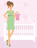 Pregnant woman in a room of her future baby Stock Photography