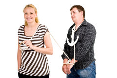 Pregnant woman with roped man Royalty Free Stock Images