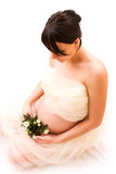 Pregnant woman with rose Royalty Free Stock Photography