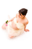 Pregnant woman with rose Stock Photos