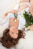 Pregnant woman with roses Stock Image