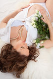 Pregnant woman with roses Royalty Free Stock Photography