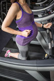 Pregnant woman running on treadmill Royalty Free Stock Photography