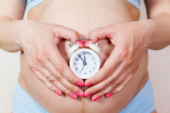 Pregnant woman's belly closeup Stock Photos