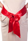 Pregnant Woman's Belly with Red Ribbon Stock Image