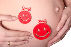 Pregnant woman's belly with smiles  Stock Photo