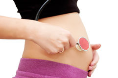 Pregnant woman's belly with stethoscope Royalty Free Stock Photography