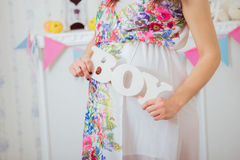 Pregnant woman's belly. Women's Health and Pregnancy Royalty Free Stock Photos