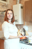 Pregnant woman with salmon Stock Images