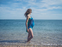 Pregnant woman in sarong on the beach Royalty Free Stock Photography