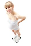 Pregnant woman on scale Royalty Free Stock Photo