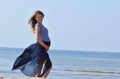 Pregnant woman at sea Stock Photos