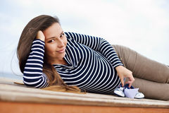 Pregnant woman on the sea coast Royalty Free Stock Photo