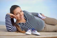 Pregnant woman on the sea coast Stock Photo