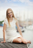 Pregnant  woman  in sea port Royalty Free Stock Photos