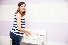 Pregnant woman setting a changing station Stock Photos