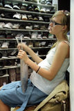 Pregnant woman in the shoe shop Stock Images