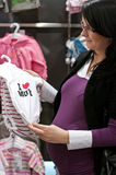 Pregnant woman shopping Royalty Free Stock Photos
