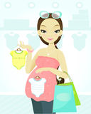 Pregnant woman shopping Royalty Free Stock Images