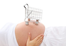 Pregnant Woman and Shopping. A pregnant woman with a small shopping cart on stomach Royalty Free Stock Image