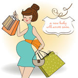 Pregnant woman on shopping Royalty Free Stock Image