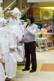 Pregnant woman shopping stock images