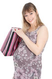 Pregnant woman with shopping bag Royalty Free Stock Images
