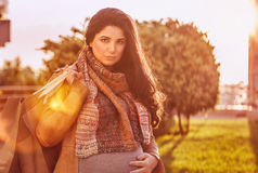 Pregnant woman with shopping bag Royalty Free Stock Image