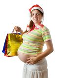 Pregnant woman with shopping bags. Isolated over white background Royalty Free Stock Images