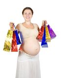 Pregnant woman with shopping bags Royalty Free Stock Photo