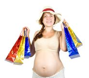 Pregnant woman with shopping bags Stock Photos