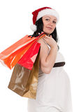 Pregnant woman with shopping bags Royalty Free Stock Photography