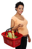 Pregnant woman with shopping basket. Isolated on white Royalty Free Stock Photo