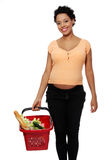 Pregnant woman with shopping basket. Isolated on white Royalty Free Stock Image