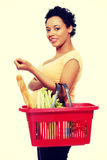 Pregnant woman with shopping basket.  Stock Photo
