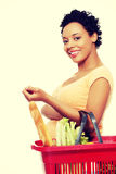 Pregnant woman with shopping basket.  Stock Photos
