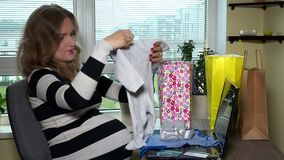 Pregnant woman shopping online concept stock video