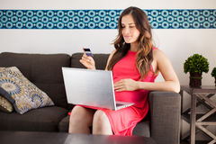 Pregnant woman shopping online Stock Image