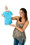 Pregnant Woman Showing Baby Clothes Stock Photos