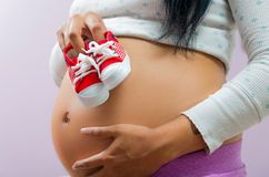 Pregnant woman showing belly to camera Stock Image