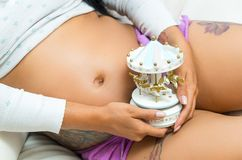 Pregnant woman showing belly to camera Royalty Free Stock Images