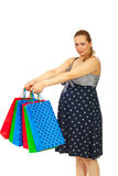 Pregnant woman showing many bags Stock Photos