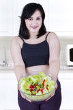 Pregnant woman showing salad Stock Images
