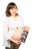 Pregnant Woman Showing an Ultrasound Image Stock Photography