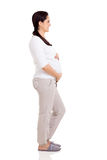 Pregnant woman side view. Side view of happy pregnant woman full length on white background Royalty Free Stock Photo