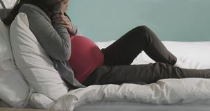 Pregnant women feel depression. Pregnant woman sit on the bed and feel depression at home stock photography