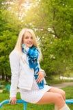 Pregnant woman sitting bench park Stock Photo