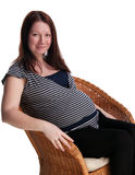 Pregnant woman sitting on the chair Royalty Free Stock Image
